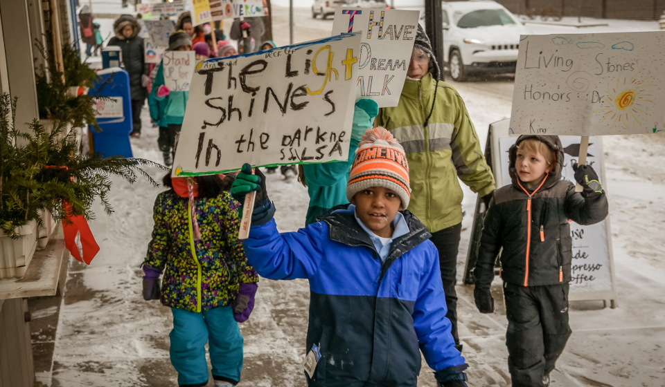 children holding signs while they march